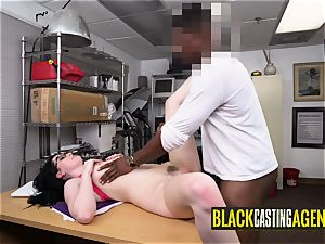 Norah satiates super-naughty director by letting him pummel her on desk