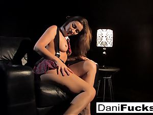 Dani gets off playing with her taut vag