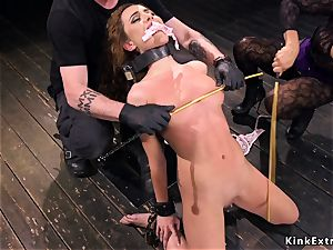 blond slave double caned in dungeon space