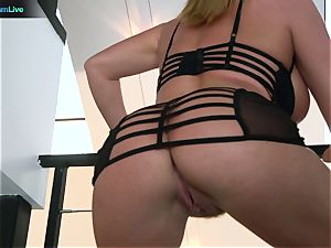 Krissy Lynn brings her humungous tits and bum on the table