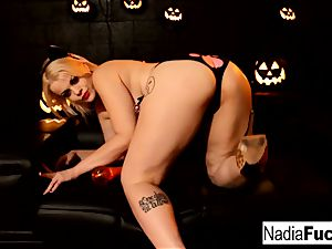 Nadia celebrates Halloween by cumming!