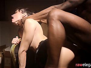 Cumcovered Eurobabe riding ebony dong