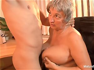 Mature plumper takes a load on her massive all-natural orbs